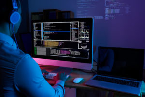 it-specialist-checking-code-computer-dark-office-night_1098-18699